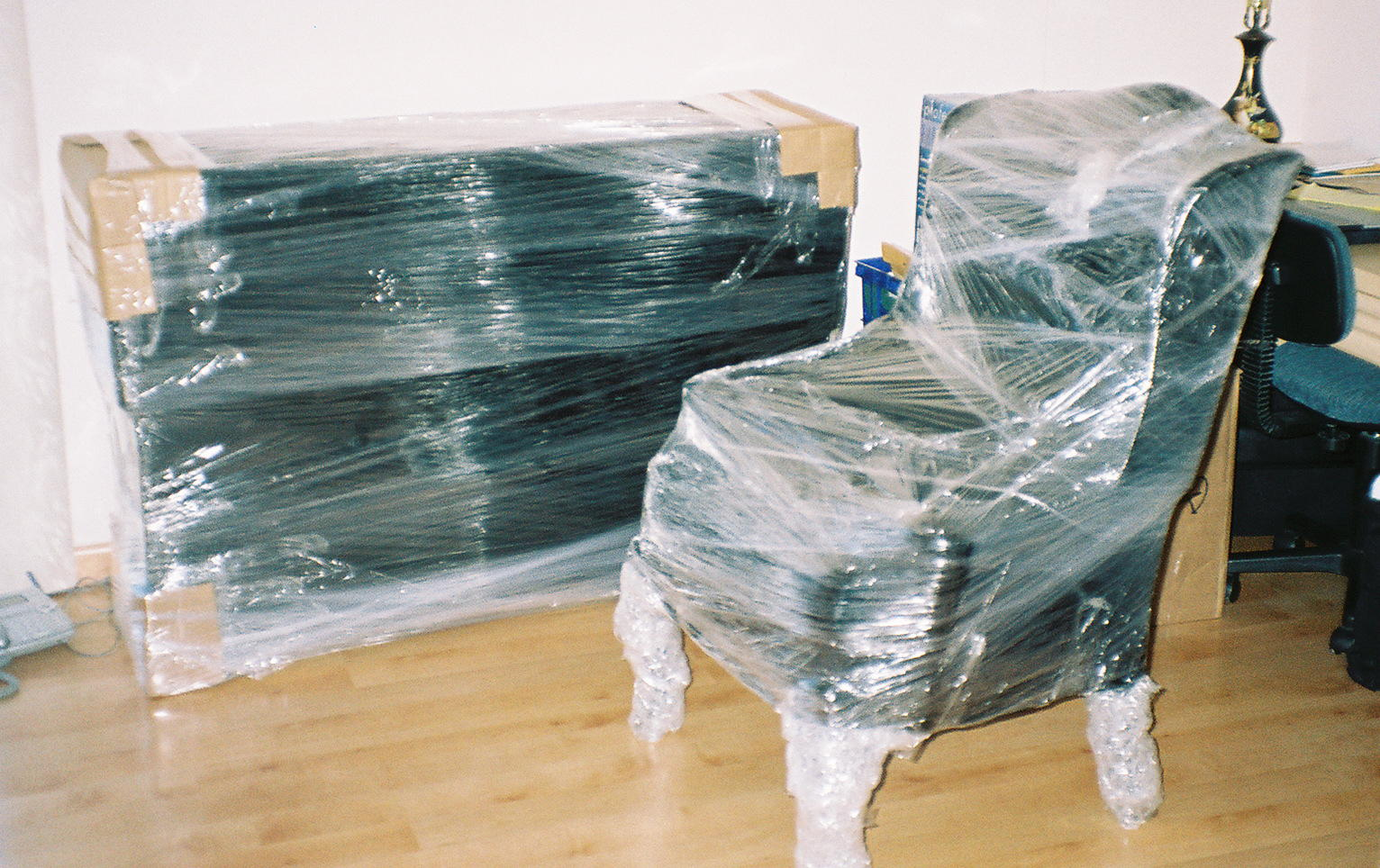 PACKING - WRAPPING BUFFET AND CHAIR - PACKING SERVICE INC
