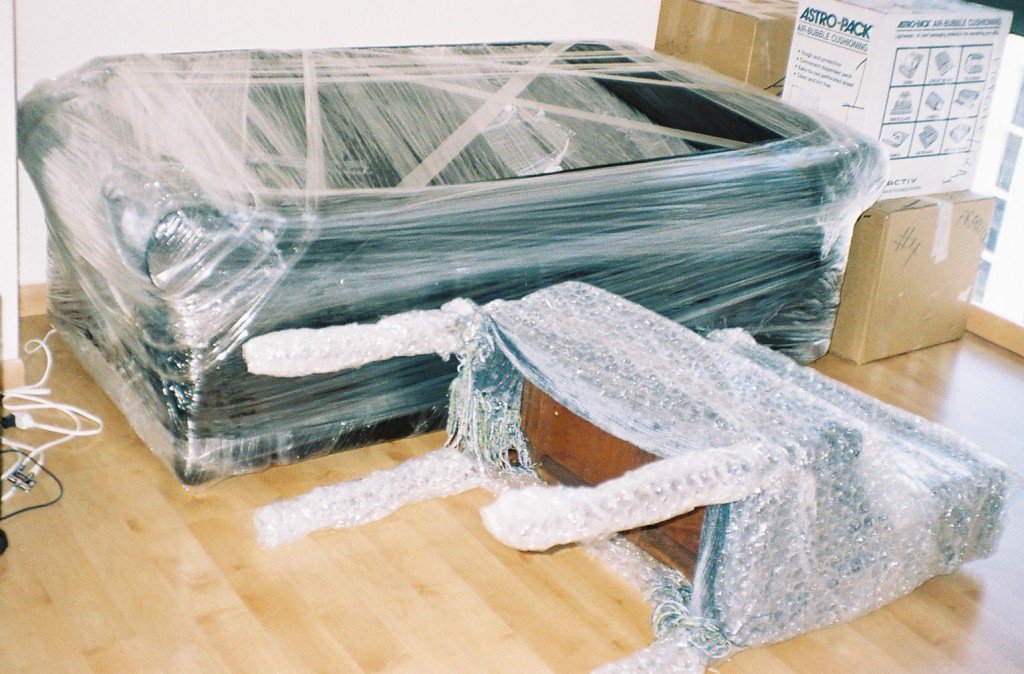 PACKING - WRAPPING SOFA AND DESK - PACKING SERVICE INC