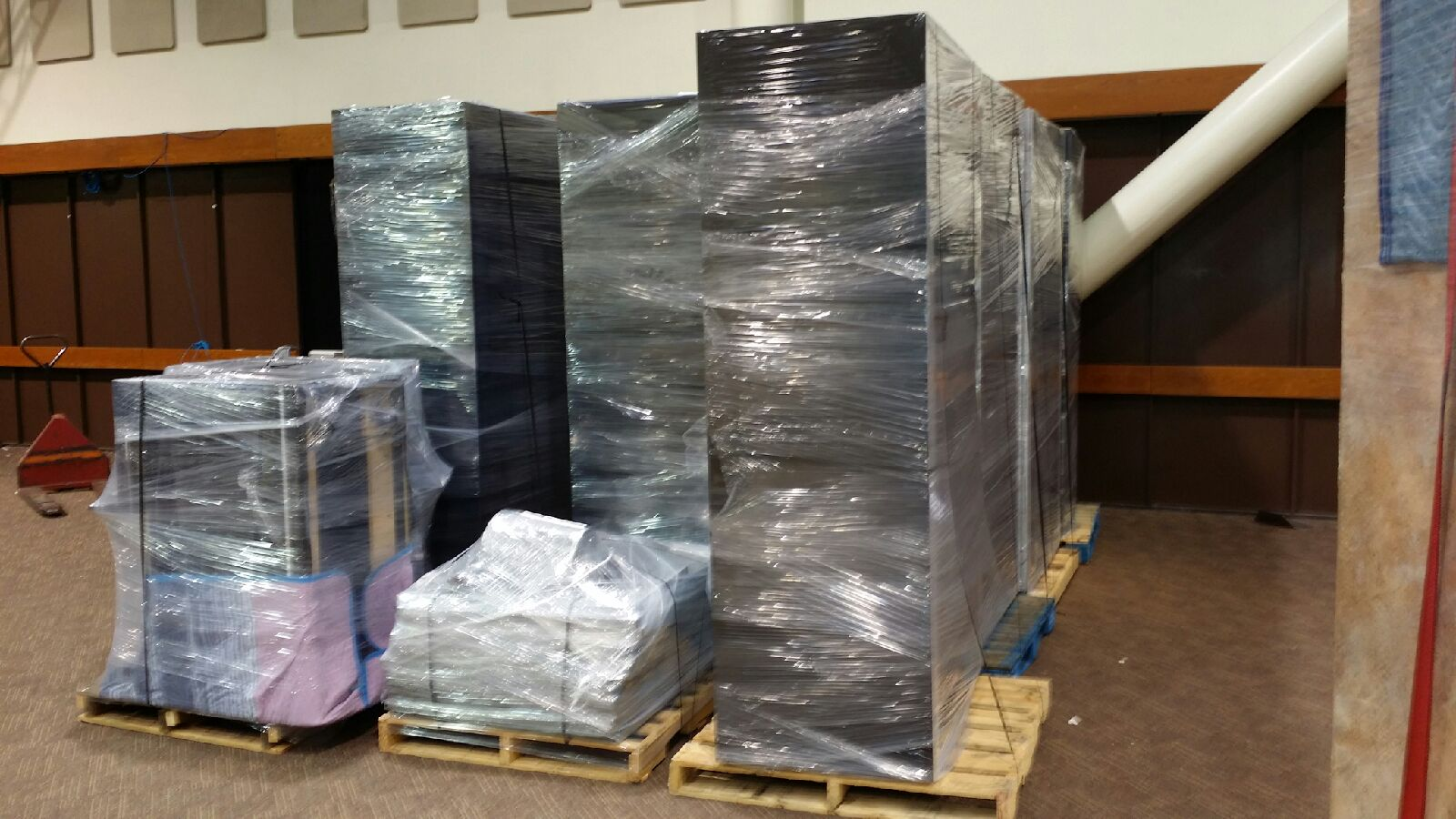 We are Professional Palletizers Packing Service Inc. palletize boxes palletize furniture shirnk wrapping palletizing 1