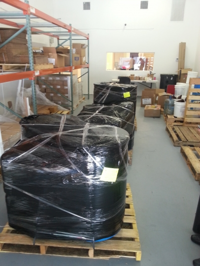 Shrink Wrapping and preparing for shipping by Packing Service, Inc. 4