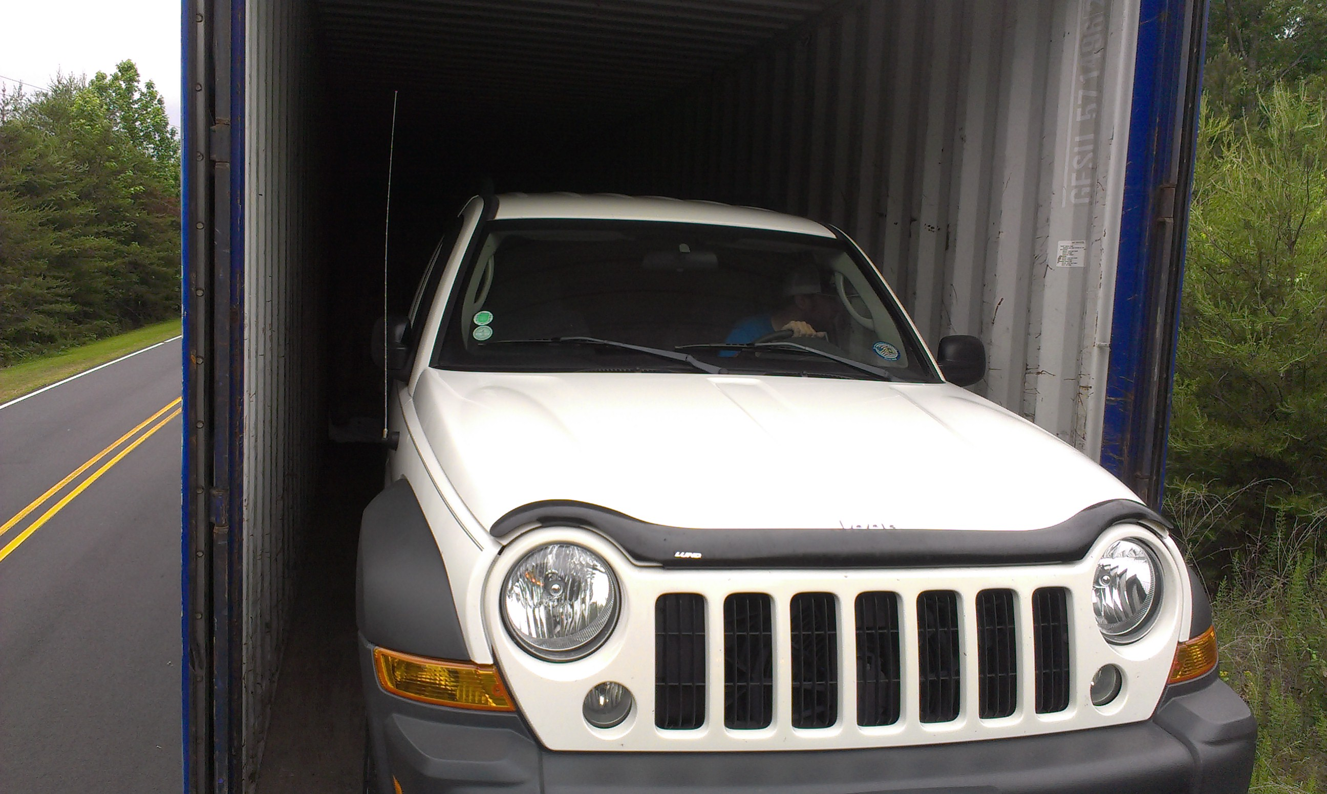 Packing Service, Inc. Loading Car into Shipping Container