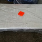 shrink-wrapped-table-long-table